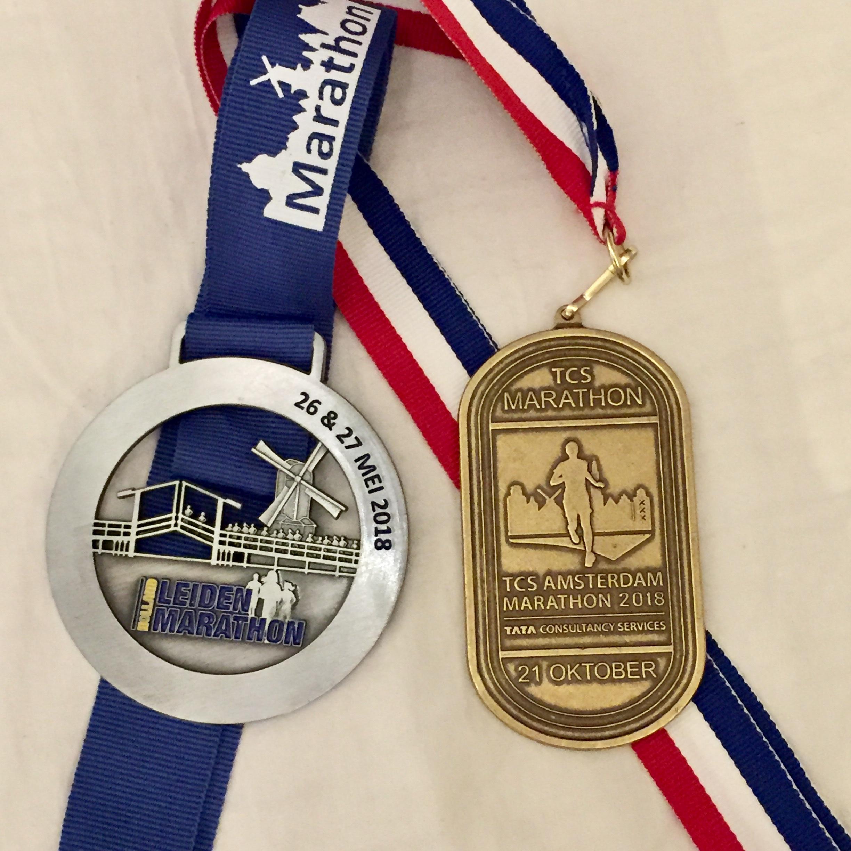 Mijn twee marathonmedailles van 2018